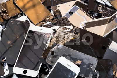Stack of damaged smart phone body and cracked LCD screen Stock Photo