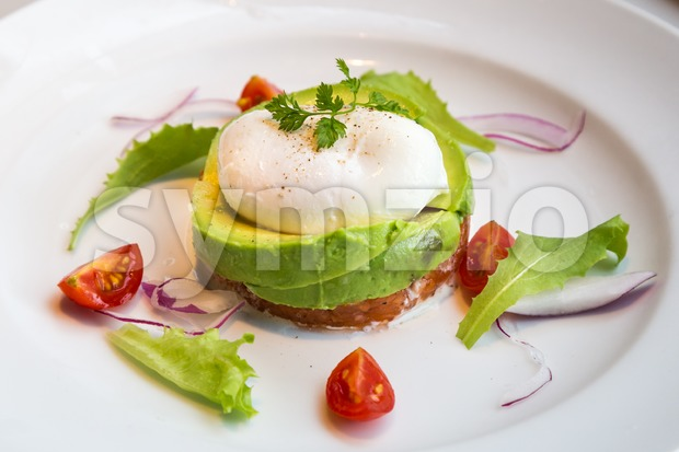 Healthy avocado poached eggs breakfast set Stock Photo