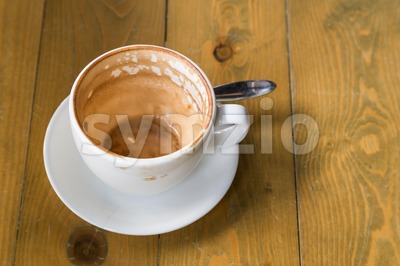 Empty cup and saucer with coffee stain Stock Photo