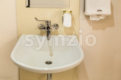 Washbasin with soap hand sanitizer and tissue paper Stock Photo