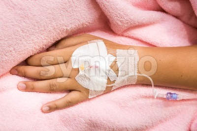 Patient hand in hospital with saline intravenous iv Stock Photo