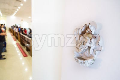 Holy water font at entrance of Catholic church Stock Photo