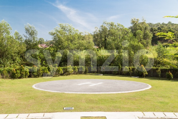 Helipad for helicopter landing within greenery Stock Photo