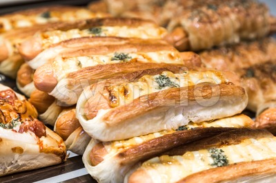 Tray of freshly baked gluten free bread with sausage cheese Stock Photo