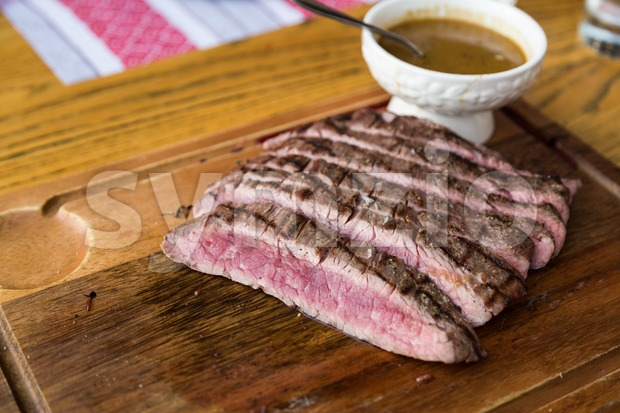 Juicy medium rare beef slice with sauce Stock Photo