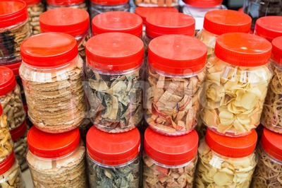 Variety Chinese New Year cookies in jars Stock Photo