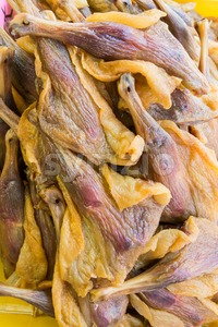 Heap of Chinese preserved waxed duck thigh Stock Photo