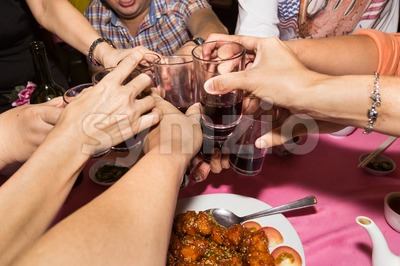 Group of Chinese toasting wine during meal celebration Stock Photo