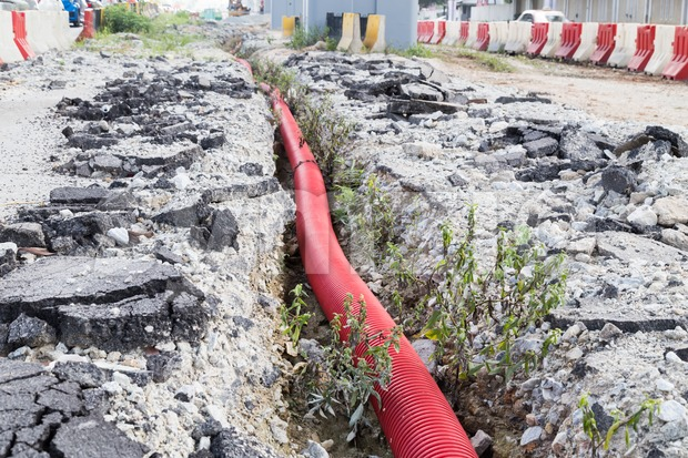 Underground trench with sewage piping at infrastructure construction site Stock Photo