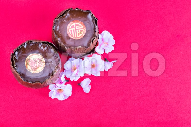 Overhead view of Nian Gao or glutinous rice cake with Good Luck in Chinese words with red background