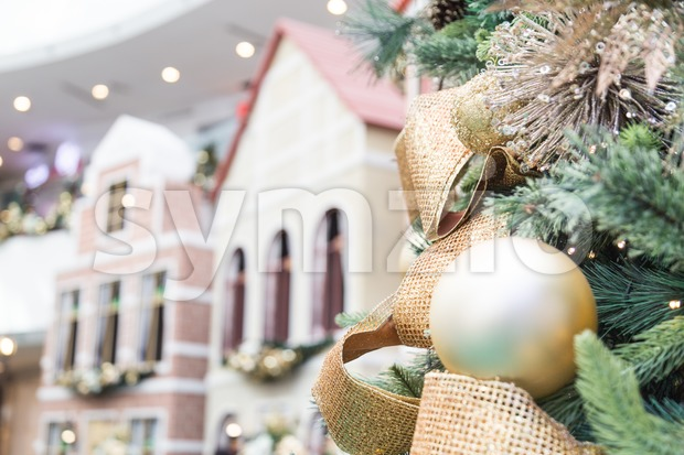 Closeup of Christmas tree with ornaments and home background Stock Photo