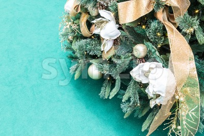 Closeup of Christmas tree with ornaments and green background Stock Photo