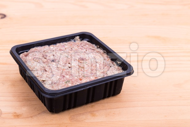 Convenient nutritious packaged minced raw meat dog food in tub Stock Photo