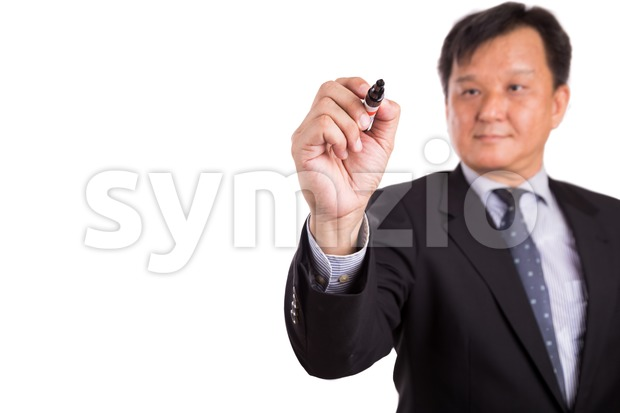 Asian business man in suit writing with marker pen Stock Photo