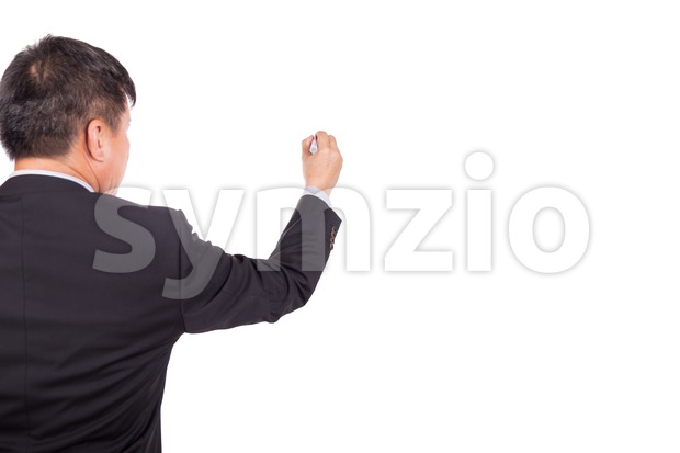 Asian business man in suit writing with marker pen on white background