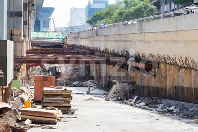 Construction of tunnel underpass beneath train line within city setting Stock Photo