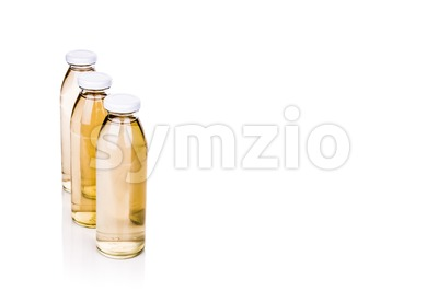 Three translucent liquid in glass bottle on white background Stock Photo