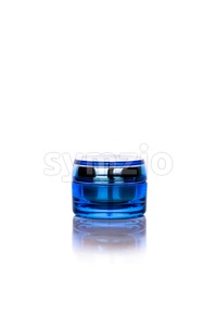 Blue skincare cosmetic jar on vertical background Stock Photo