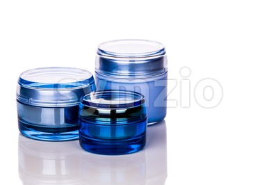 Blue skincare cosmetic jar on white background Stock Photo