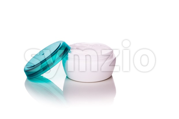 Skincare cosmetic jar with cream on white background