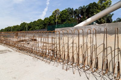 Steel rebar and concrete divider being constructed at construction site Stock Photo