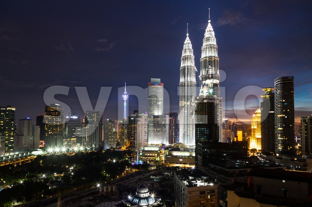 KUALA LUMPUR, MALAYSIA - JULY 23, 2016: View of the Petronas Twin Towers at KLCC City Center and KL Tower ...
