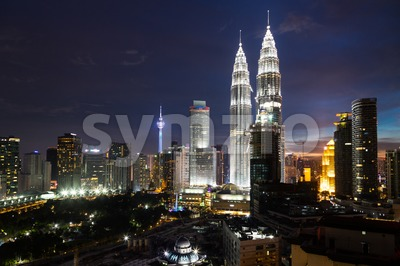 KUALA LUMPUR, MALAYSIA - JULY 23, 2016: View of the Petronas Twin Towers and KL Tower at KLCC City Center during dusk hour.  The most popular tourist Stock Photo