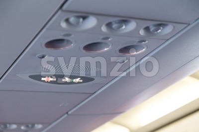 Plane interior No Smoking and Buckle Seat-Belt signage Stock Photo