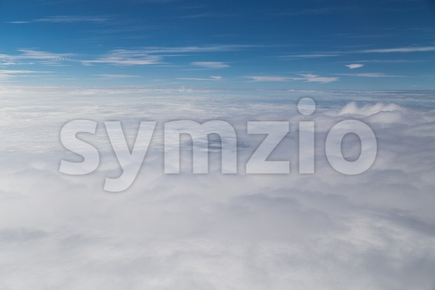Scenic beautiful cloudscape view from plane window Stock Photo