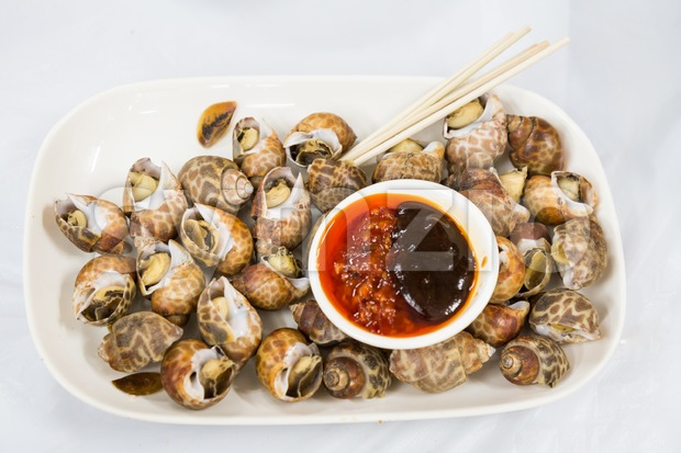 Sea snails with chili sauce dip is delicacy among Chinese in Hong Kong