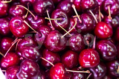 Heap of freshly harvested sweet and juicy organic cherries Stock Photo