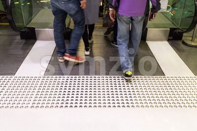 Tactile paving path for the blind entrance exit of escalator Stock Photo