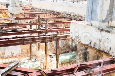 Closeup on construction digging of tunnel underpass with metal beams Stock Photo
