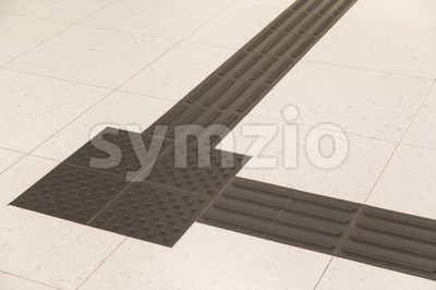 Closeup on Indoor tactile paving foot path for the blind Stock Photo