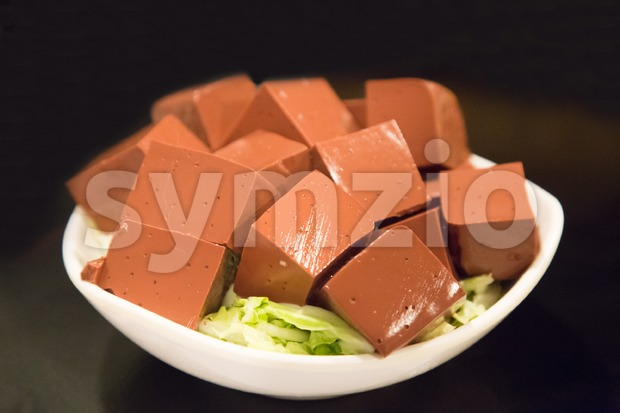Plate of hardened pig blood in cubes, food delicacy among Chinese