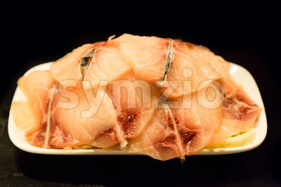 Fish fillet as ingredient for cooking on plate Stock Photo