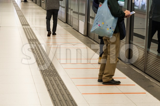 Tactile paving foot path for the blind subway station Stock Photo
