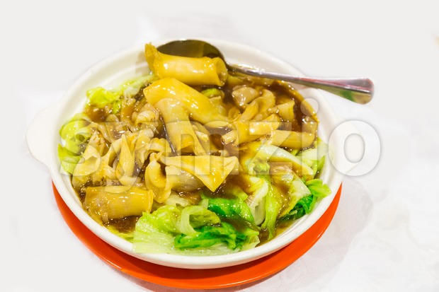 Chinese delicacy braised fish maw with vegetable served in bowl Stock Photo