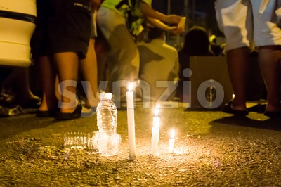 People with candle vigil in darkness seeking hope, worship, prayer Stock Photo