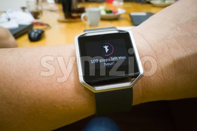 Perspective view of person reading watch with heart steps tracker Stock Photo