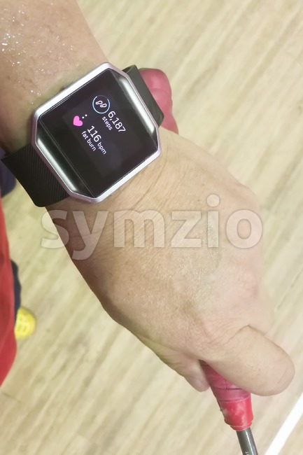 Perspective view person reading watch with heart tracker during exercise Stock Photo