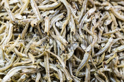 Heap of dried and salted anchovy fish Stock Photo