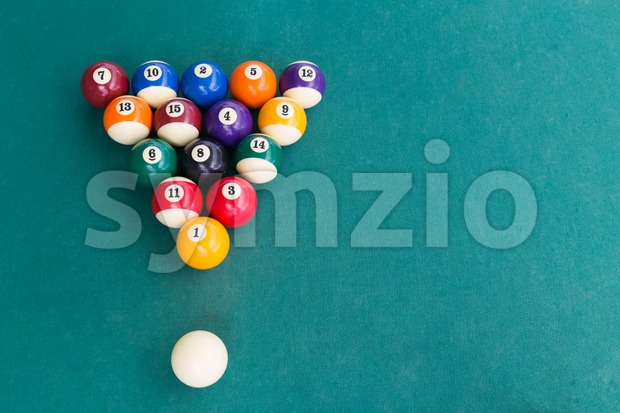 Overhead view of pool billards snooker balls on green table Stock Photo