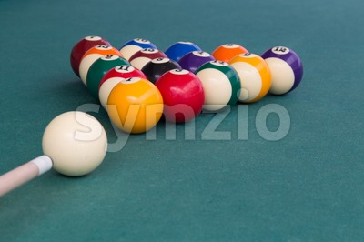 Cue aiming white ball to break snooker billards on table Stock Photo
