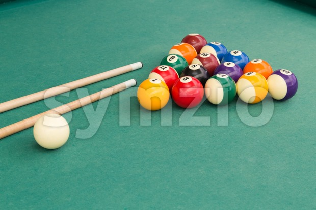Snooker billards pool balls and cue stick on green table Stock Photo