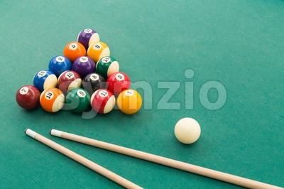 Snooker billards pool balls, cue, extender stick on green table Stock Photo