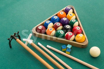 Snooker billards pool balls, cue, chalk on green table Stock Photo