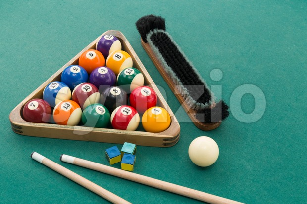 Snooker billards pool balls, cue, brush, chalk on green table Stock Photo