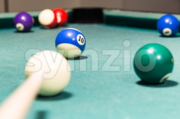 Cue aiming red ball into snooker pool billards table pocket