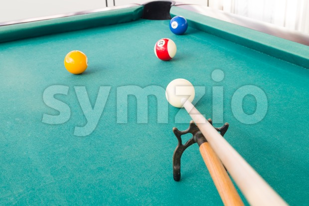 Aiming ball using extender stick during snooker billards game Stock Photo